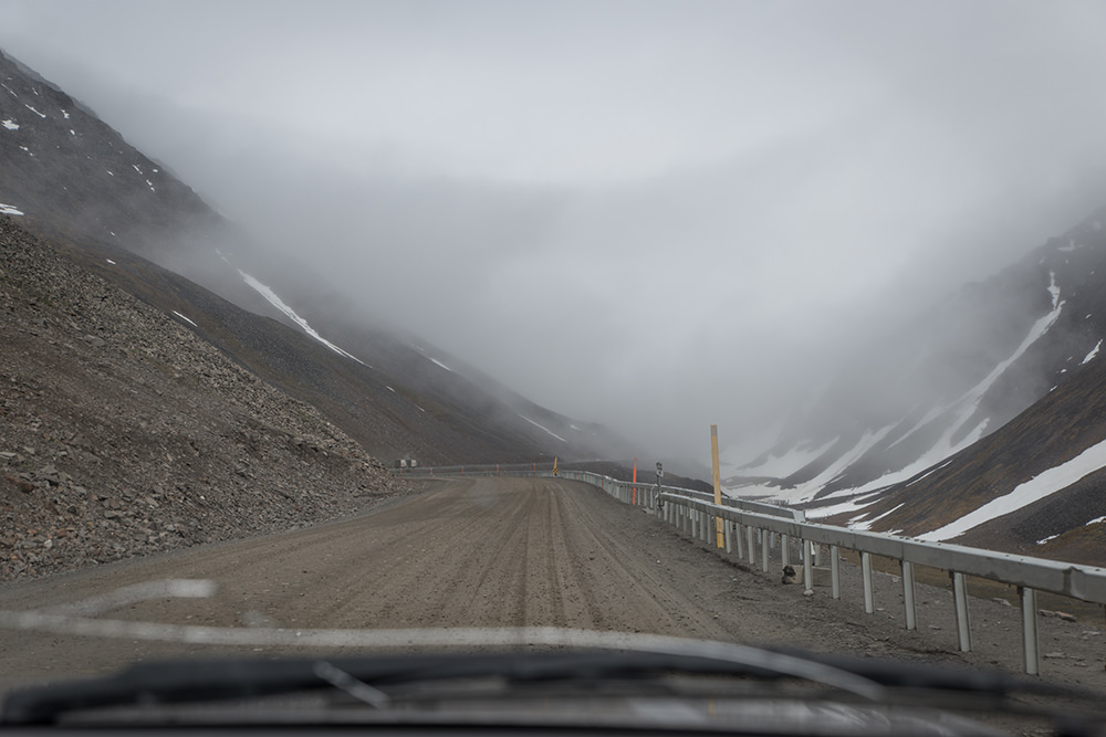Driving into the storm at the top of Atigun Pass