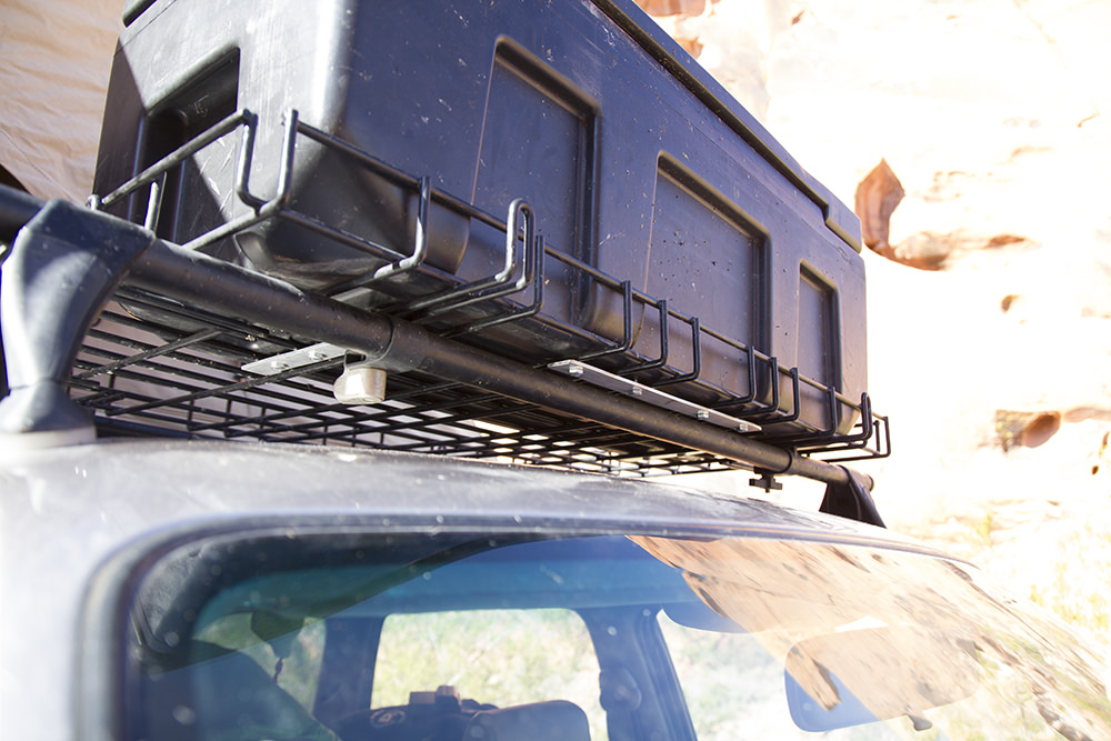 Storage box bolted to roof rack.