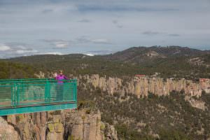 Emma couldn't resist any opportunity to dangle in relative safety over the rim of the canyon.
