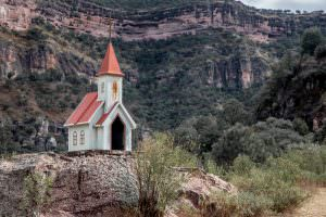 One of the many small roadside shrines, we saw a couple in the style of miniature churches like this one.