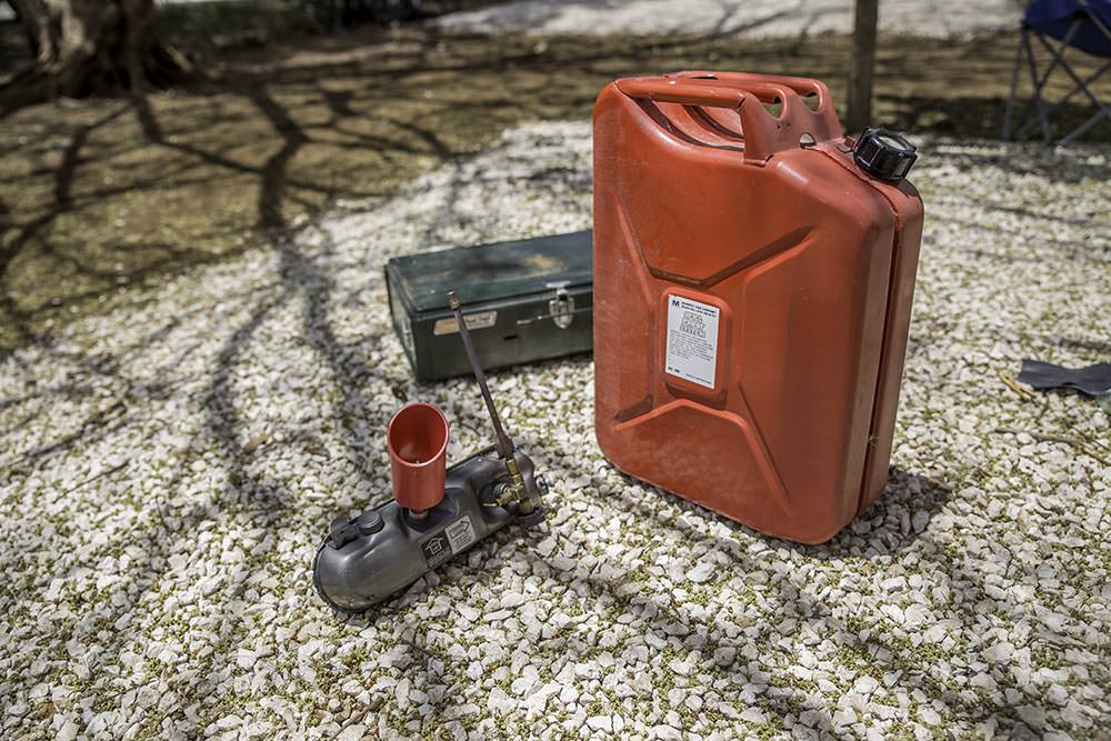 We recommend filling from something a little easier to manoeuvre than this large jerry can. But it does the trick.