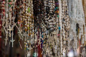 Rosary beads for sale outside the cathedral.