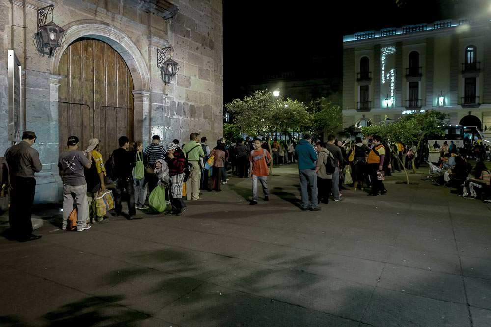 These people are queueing for the bus in a plaza in Guadalajara. First of all, that is a crazy long queue to have to wait in every day after work. Secondly, these must be the most orderly queues for public transport we have ever seen.