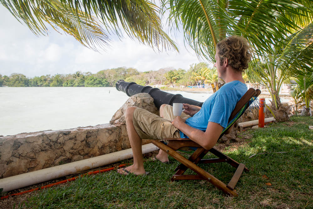 Ben enjoys a morning coffee stationed at the cannon overlooking the windy Caribbean.