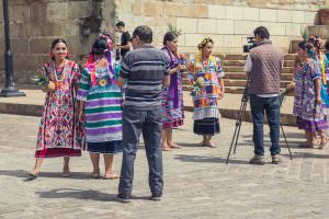 Dancers arriving for the Gualaguetza festival shooting promo videos in town.